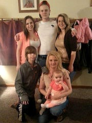 A Cook family photo from 2014 shows (back row) Keaton, Kevin and Kelsi Cook along with (front row) Kaden with his mom Trishann Cruickshank and daughter Khloe Cruickshank, 2.