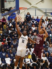 Poughkeepsie High School's Anatwone West takes a layup against Johnson City during a Class A regional semifinal game at SUNY New Paltz on Wednesday.