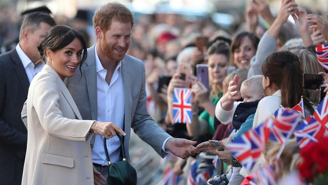 Britain's Prince Harry and Meghan, the Duchess of Sussex greet well wishers, Wednesday, during their visit to Chichester, south east England. The Duke and Duchess of Sussex made their first joint official visit to Sussex.
