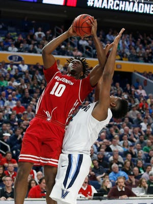 Wisconsin Badgers forward Nigel Hayes (10) shoots over Villanova Wildcats forward Kris Jenkins (2) in the second half during the second round of the 2017 NCAA Tournament.