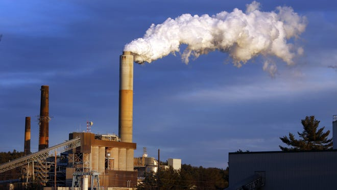 A plume of steam billows from the coal-fired Merrimack Station Jan. 20, 2015, in Bow, N.H.