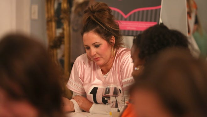 Melissa Whitworth, wife to Bengals player, Andrew Whitworth, participates in a charity bunco night.