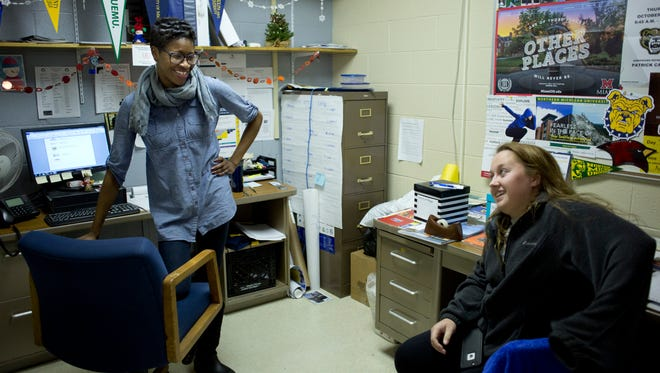 College adviser Cece Sumpter laughs while talking with senior Katlyn Mathers, 17, Tuesday, at Port Huron Northern High School.