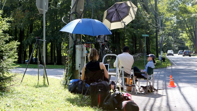 Media down the block from the home of Democratic presidential candidate Hillary Clinton in Chappaqua, Sept. 13, 2016.