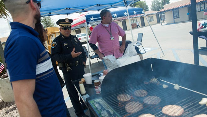 Deputy Chief of Police Justin Dunivan picks up free lunches for first responders during an event in July 2017. On Monday, March 26, 2018, the Las Cruces City Council was briefed on a new proposal that would allow uniformed officers to work outside their normal hours, patrolling at businesses or other entities willing to pay them.