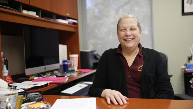 FSU professor and speech pathologist Lisa Scott in her office Oct 25. After two previous battles with cancer, Scott was re-diagnosed with stage four breast cancer last December.
