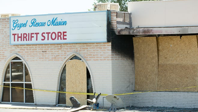 The windows are boarded up on Saturday, June 23, 2018, after a fire broke out at the Last Cruces Gospel Rescue Mission Thrift Store at 1420 S. Solano Dr.