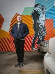 """Van Holmgren with his mural for ABC's """"The Bachelor"""""""