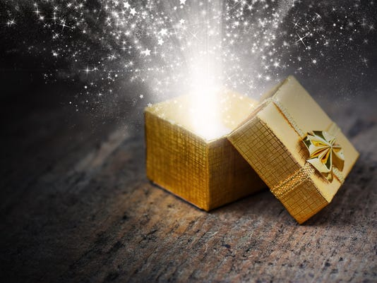 Magical gift with rays and sparks