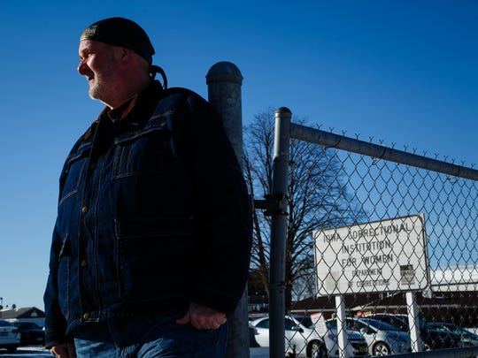 """I think this is part of his legacy. It's one of his main points he used to get elected but I think the focus was in the wrong areas to accomplish it,"" said Ron Forget, a former corrections officer for Iowa prisons in Newton and Mitchellville. Here he poses for a photo in front of the Mitchellville prison on Friday, Jan. 27, 2017, in Mitchellville."