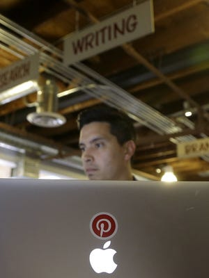 Pinterest market researcher Paul Pattishall works at his desk at the office in San Francisco.