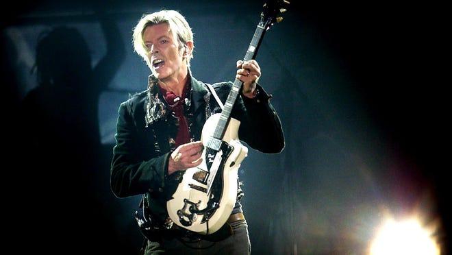 Rock legend David Bowie, shown performing in Copenhagen in 2003.