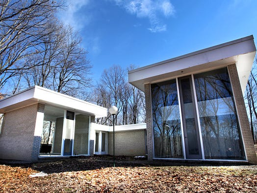 The mid-century modern home was designed in 1961 by Courtenay Macomber. The house has been vacantsince the Macomber, also the owner, died last year.<br /> It is located deep in the woods of 18 acres in Pike Twp. Asking price with land, $600,000.