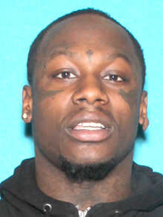 """Carlos Davis,  """"Loso,"""" 24, of Detroit, is wanted by"""