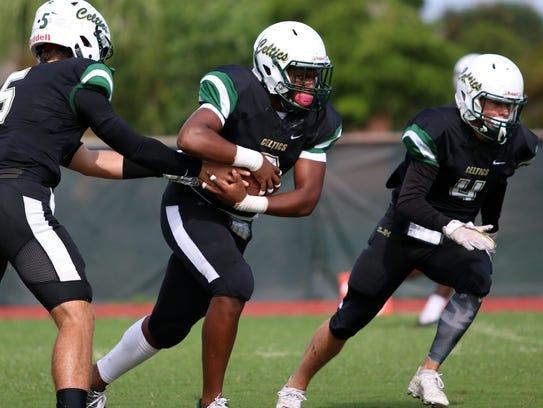 St. John Neumann quarterback Jensen Jones (5) hands