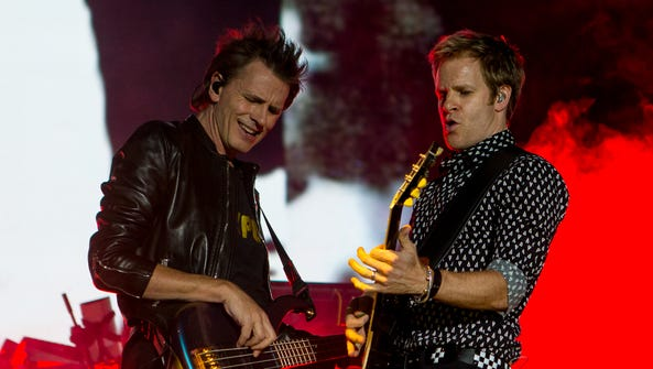John Taylor, left, and Dom Brown of Duran Duran perform