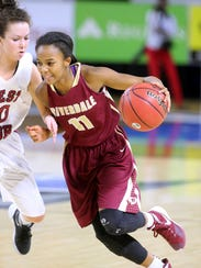 Riverdale's Aislynn Hayes (11) pushes toward the basket