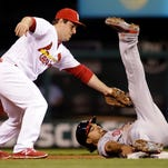 Washington Nationals' Anthony Rendon, right, is tagged at second by St. Louis Cardinals shortstop Jedd Gyorko and ruled out during the fourth inning of a baseball game Friday, April 29, 2016, in St. Louis. The call was reversed after video review and Rendon went on to score later in the inning.