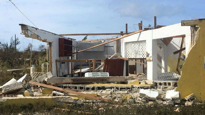 A home near West End on Grand Bahama Island was blown apart by Hurricane Matthew Thursday night.