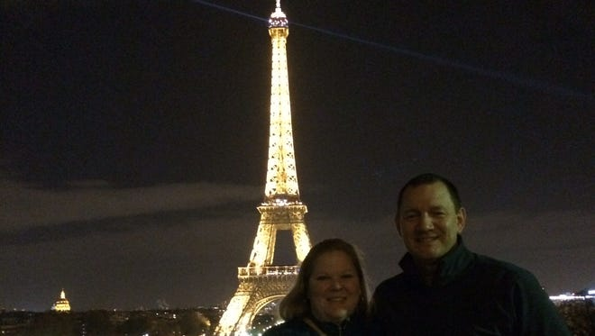 Union, Kentucky, couple Aaron and Holly Bludworth pose Friday night in front of Paris' iconic landmark The terror attacks happened about an hour later..