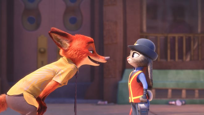 Natural enemies or new BFFs? The fast-talking Nick Wilde (voiced by Jason Bateman) meets bunny officer Judy Hopps (Ginnifer Goodwin) in Disney's 'Zootopia.'