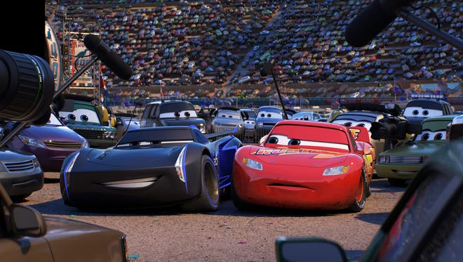 Jackson Storm (left, voiced by Armie Hammer) becomes a foil for Lightning McQueen (Owen Wilson) in 'Cars 3.'