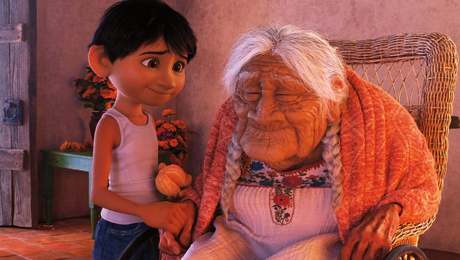 Miguel (voiced by Anthony Gonzalez) shares a moment with his great-grandmother Mamá Coco (Ana Ofelia Murguía) in Pixar's 'Coco.'