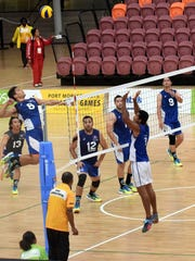 Guam men's national team member Devin Maluwelmeng prepares to spike the ball against Kiribati July 14 at the Pacific Games in Port Moresby, Papua New Guinea. The men won a five-set victory 25-18, 25-27, 21-25, 25-15, 15-6, their second straight victory at the BSP arena.