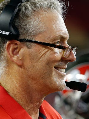 Aug 26, 2016; Tampa, FL, USA;  Tampa Bay Buccaneers head coach Dirk Koetter  smiles against the Cleveland Browns during the first half at Raymond James Stadium.