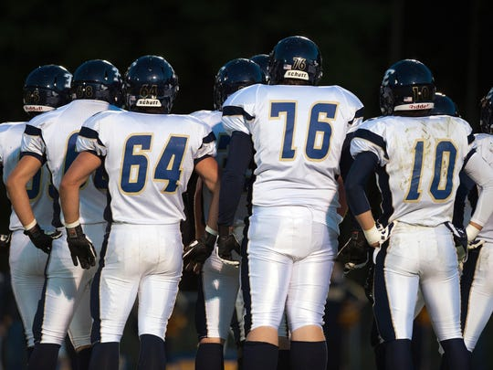 The Essex High School football team huddles up before a game last year.
