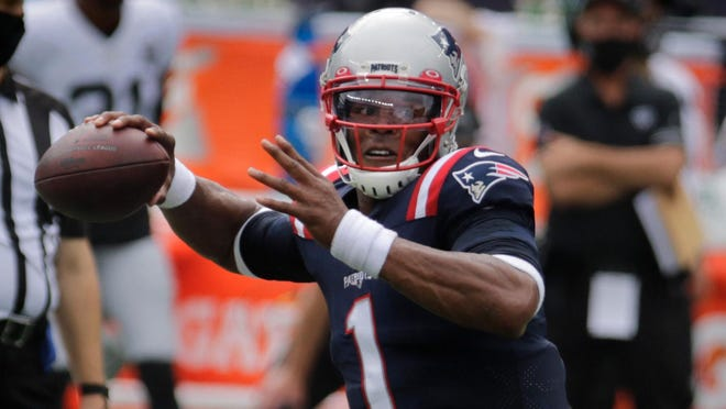 New England Patriots quarterback Cam Newton looks to pass in last Sunday's game against the Las Vegas Raiders at Gillette Stadium. He has tested positive for the coronavirus and will not play this week against the Chiefs.