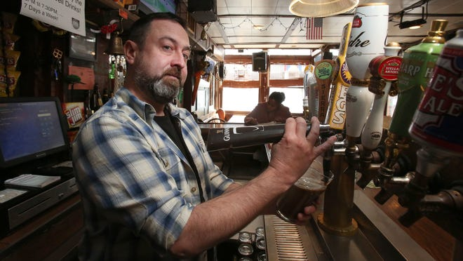 Bar Manager Brian Fitzgerald pours a Guinness at O'Donoghue's Tavern on Thursday. It was the last day of business at the Nyack restaurant and bar.