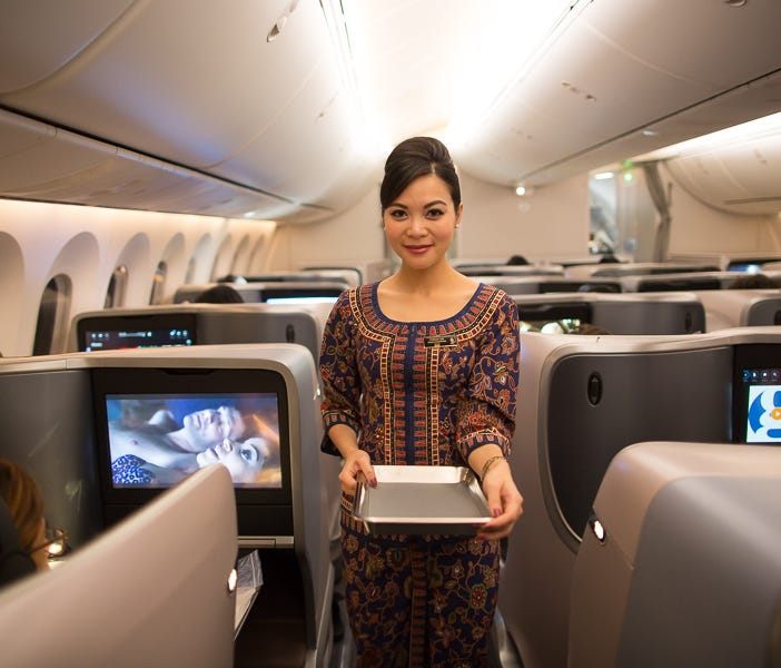 A flight attendant readies for service aboard Boeing's first 787-10 delivery to launch customer Singapore Airlines, on March 26, 2018 during its ferry flight to Singapore.