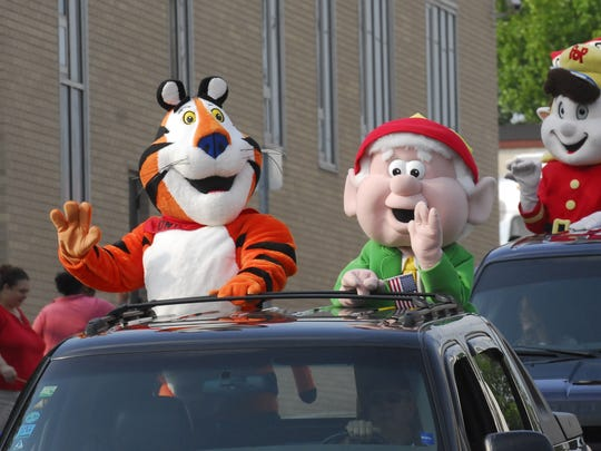 Tony the Tiger, Ernie the Elf, and Snap, Crackle and Pop in the Cereal Festival parade. Kevin Hare/the Enquirer
