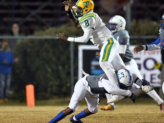 North Forrest player tackles quarterback Ty Keyes in a playoff game against Taylorsville on Friday in Hattiesburg.
