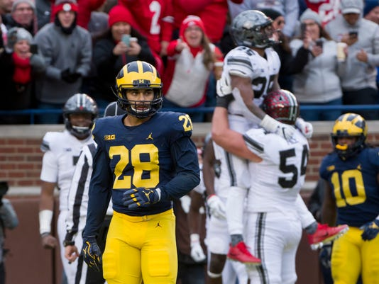 598ba7325de5de Red menace  Michigan crushed after loss to Ohio State
