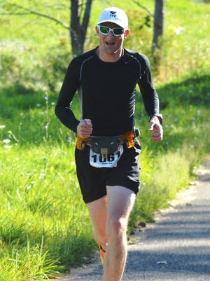 South Lyon's Simon Gore won the Witch's Hat half-marathon in 1:22:41.22 on Saturday.