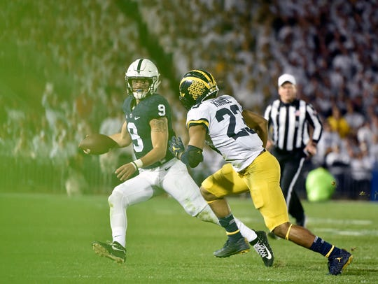 Penn State quarterback Trace McSorley is run out of