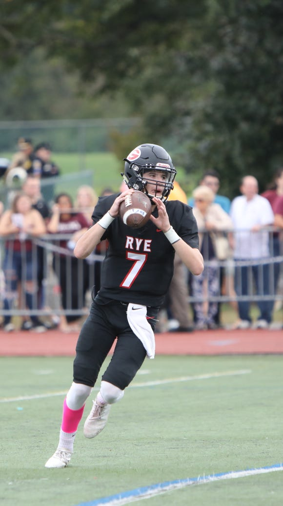 Rye quarterback Declan Lavelle looks to pass against
