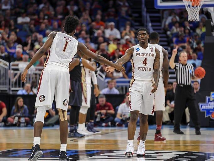 Florida State guard Dwayne Bacon (4) high fives forward