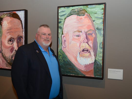 Scott Adams, who was badly wounded in Iraq, is among the subjects of former President George W. Bush's warrior paintings.