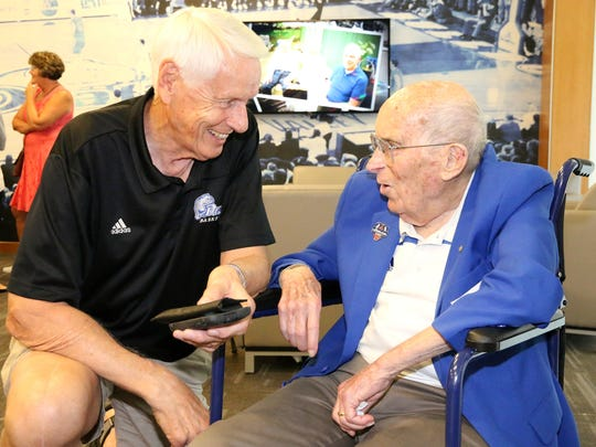 "Former Drake Basketball star David Hansen visits with Paul Morrison as Bulldog fans come together and celebrate a living legend during the 100th Birthday Party for ""Mr. Drake"" Paul Morrison in the Courtside Club of the Knapp Center, 2601 Forest Ave, in Des Moines."