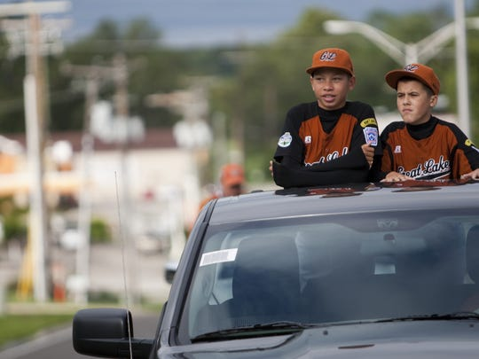 That's a younger Mason Gillis (left), and teammate Janson Anderson riding in a parade in 2012 to  honor the New Castle Little League team, who represented the Great Lakes Region at the Little League World Series.