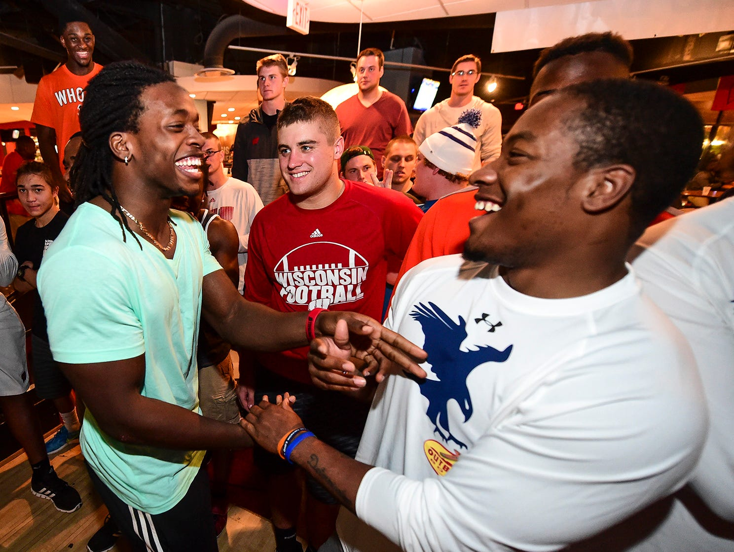 Wisconsin's Melvin Gordon (left) and Auburn's Cameron Arits-Payne during the Outback Bowl bowling competition on Sunday.