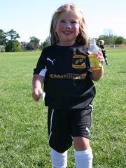Riley Slattery, 4, of Liberty Township today is cancer-free and plays soccer.