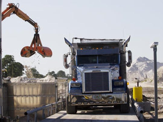 A dump truck carrying beach sand from Stewart Mining in Immokalee is weighed as part of Collier County's 2013 beach renourishment project.
