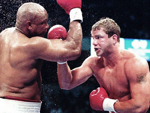 Morrison defeated George Foreman to claim the heavyweight crown on June 7, 1993.