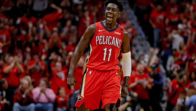 New Orleans Pelicans guard Jrue Holiday (11) reacts after a three point play during the second half in game four of the first round of the 2018 NBA Playoffs against the Portland Trail Blazers at the Smoothie King Center.