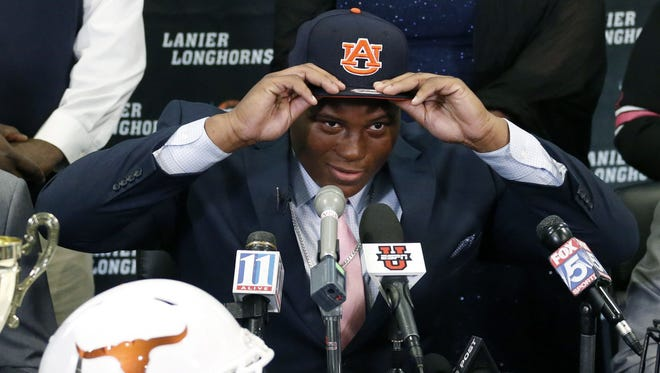Derrick Brown announces his commitment to sign with  Auburn on signing day at Lanier High School in Georgia.