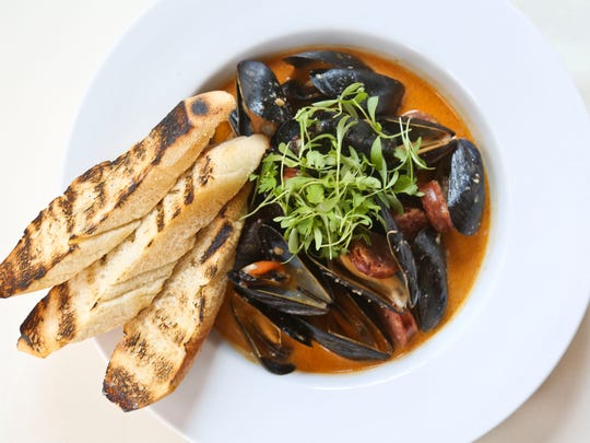 Thai Curry Mussels from Varanese on Frankfort Avenue include a sweet chili sace and sausage marinade.